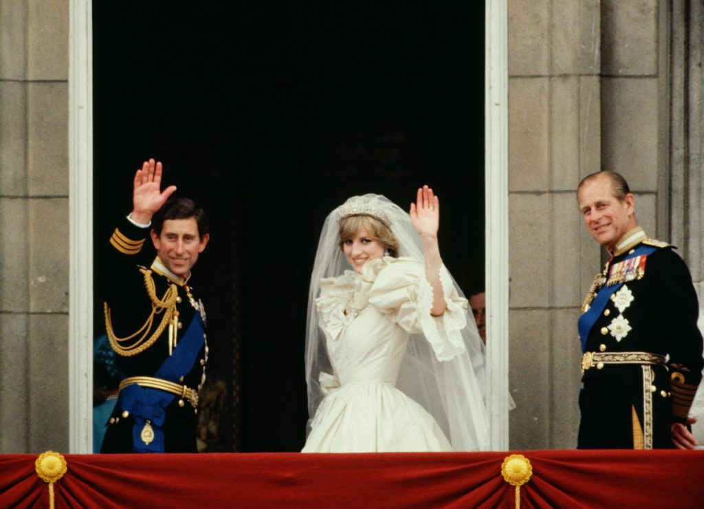 Prince Charles And Princess Diana Waving From The Balcony Of Buckingham Palace. They Are Accompanied By Prince Philip