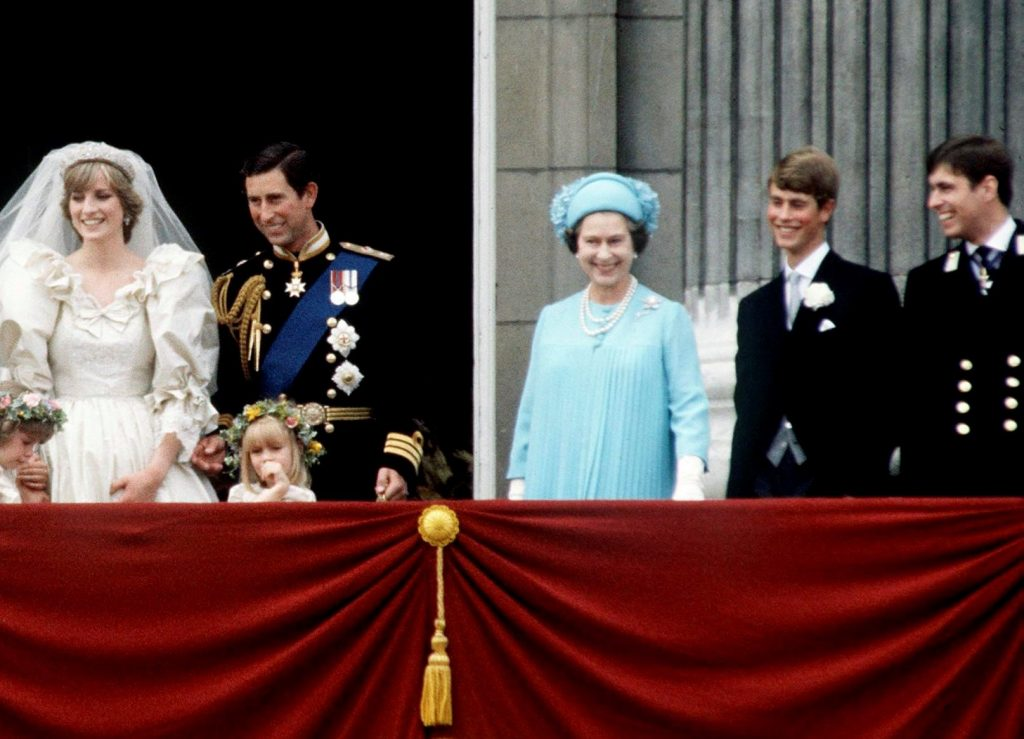 Prince Charles and Princess Diana with their bridesmaids, Queen Elizabeth II, Prince Edward, and Prince Andrew