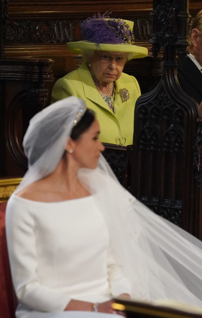 Queen Elizabeth II staring at Meghan Markle