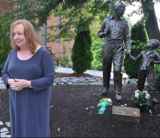 Betty Lynn standing by statue of 'The Andy Griffith Show' characters Sheriff Andy Taylor and his son Opie in her adopted hometown of Mount Airy, North Carolina