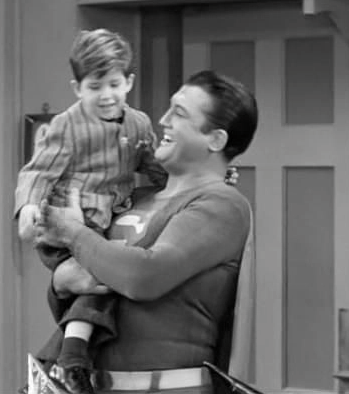 George Reeves, right, carries Keith Thibodeaux on the set of 'I Love Lucy'
