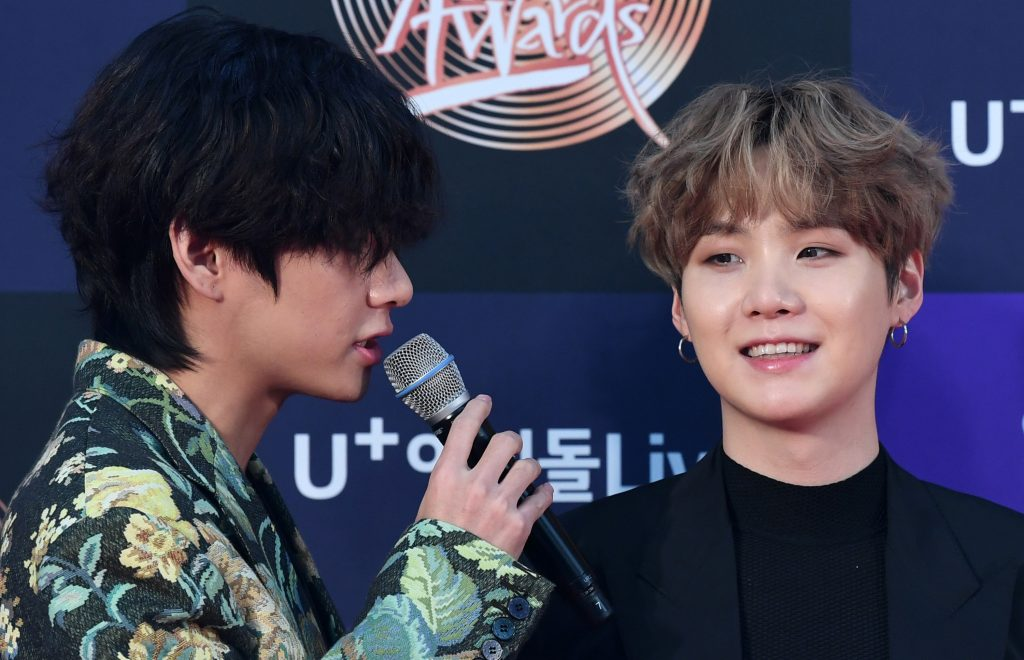 V and Suga of BTS arrive at the photo call for the 34th Golden Disc Awards