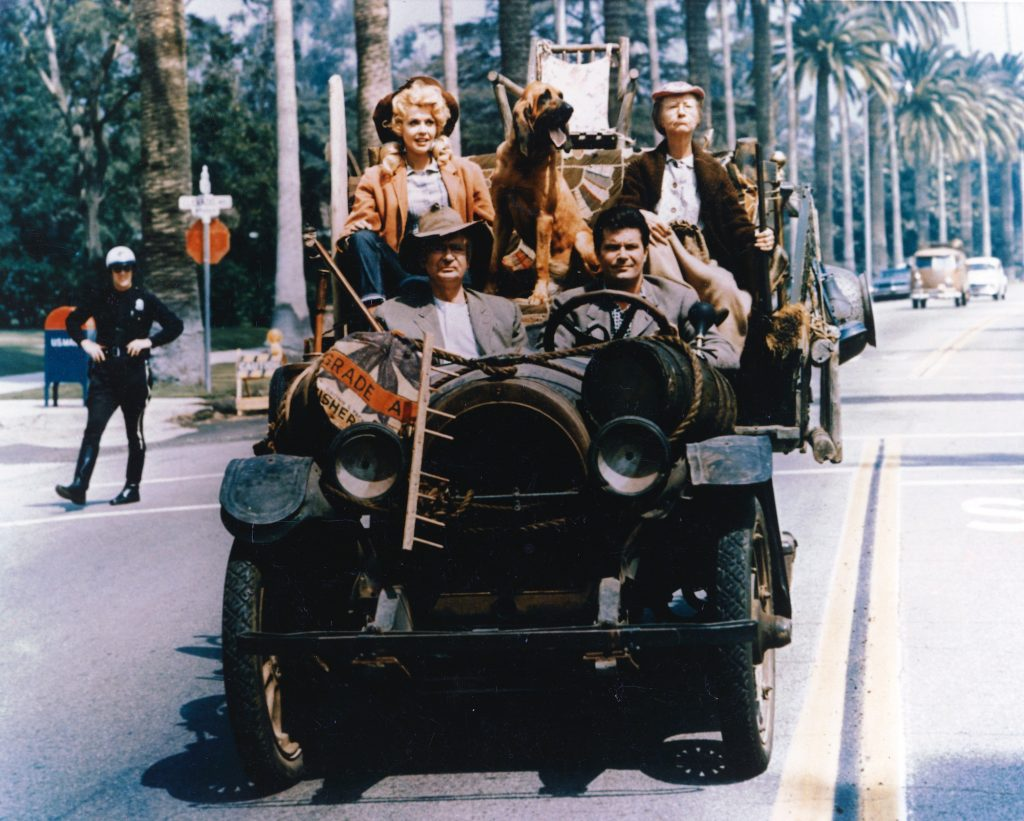 (L-R) Donna Douglas, Irene Ryan, Max Baer Jr, and Buddy Ebsen driving in an old car with no roof
