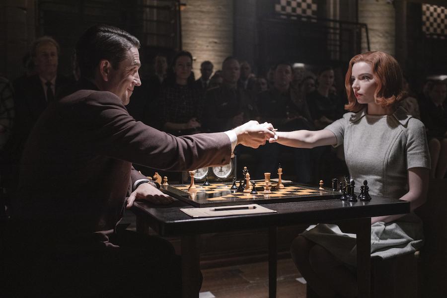 Cast members Marcin Dorocinski as Vasily Borgov and Anya Taylor-Joy as Beth Harmon in The Queen's Gambit