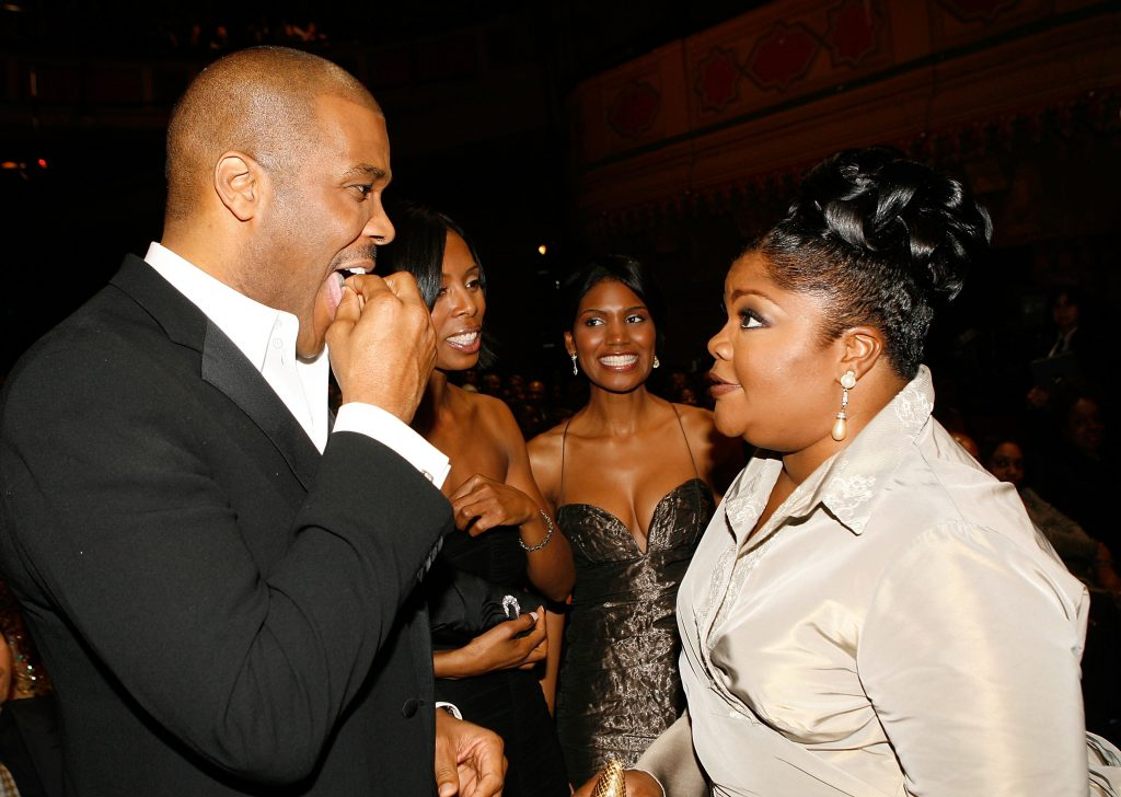 Producer/director/actor Tyler Perry (L) and comedian Mo'Nique talk in the audience during the 38th annual NAACP Image Awards held at the Shrine Auditorium on March 2, 2007 in Los Angeles, California