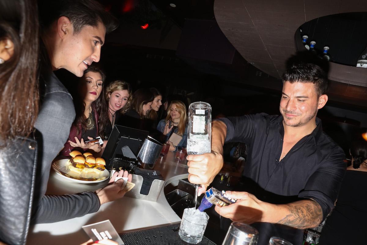 Cast member Jax Taylor tends bar at No. 8 at VanderCrawl