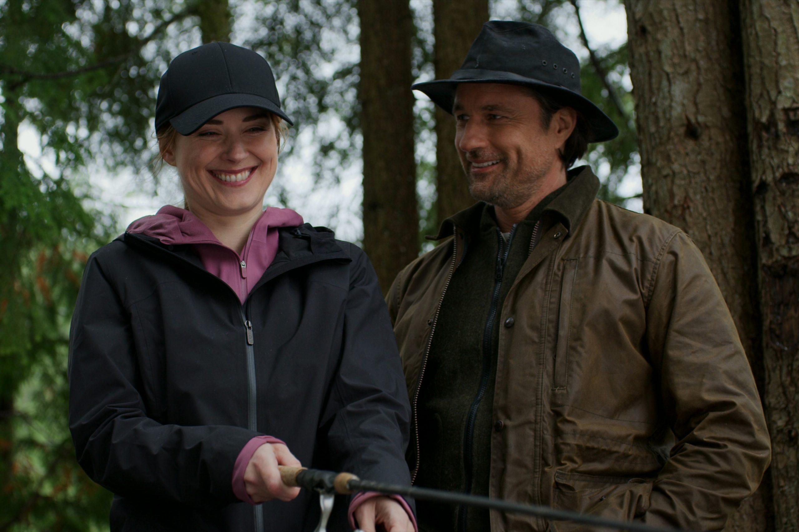 Mel and Jack, both wearing hats, fishing in an episode of 'Virgin River' Season 2.