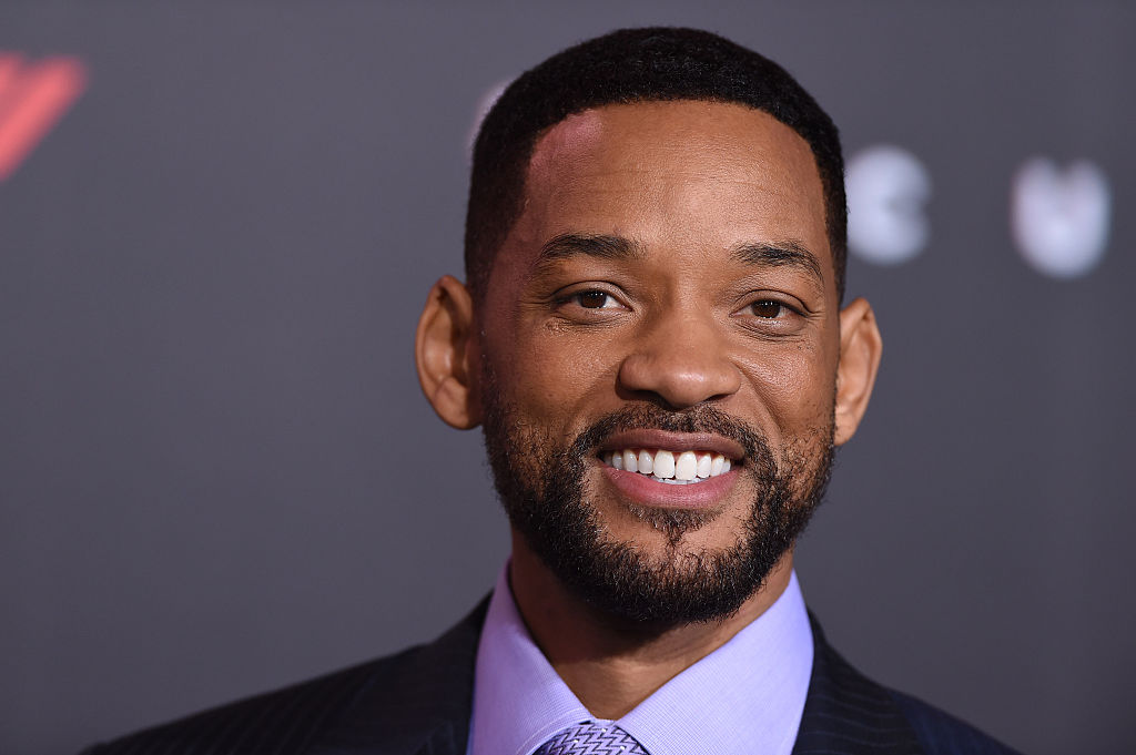 Will Smith smiling in front of a black background