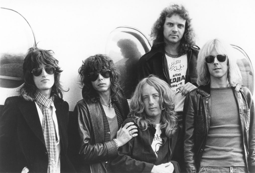Aerosmith in front of a plane