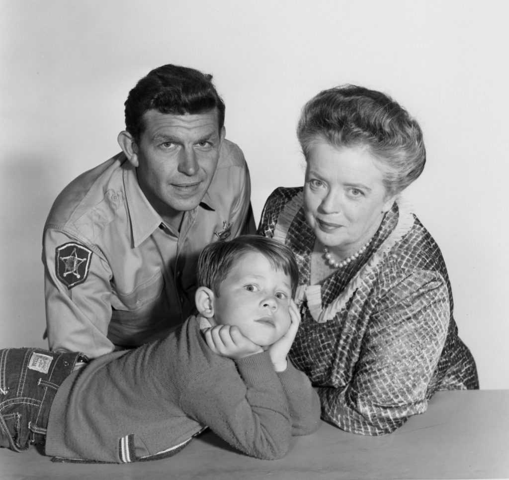 Andy Griffith, Frances Bavier, and Ron Howard looking at the viewer