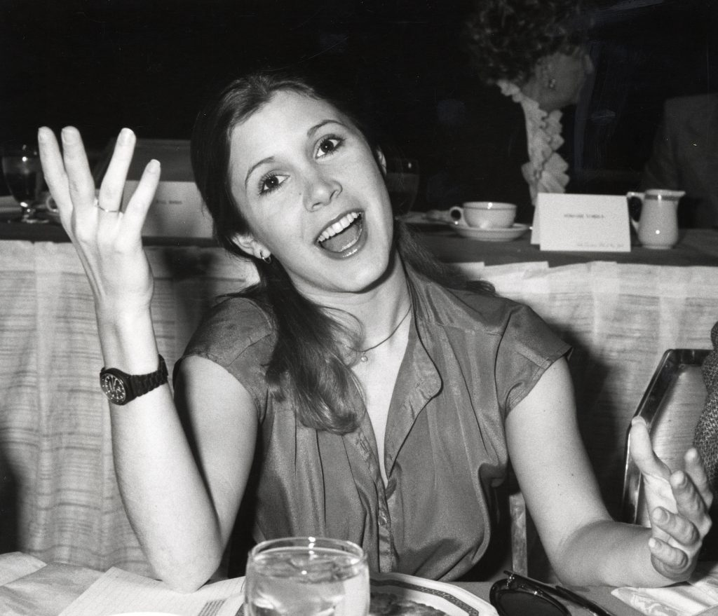 Carrie Fisher with a glass