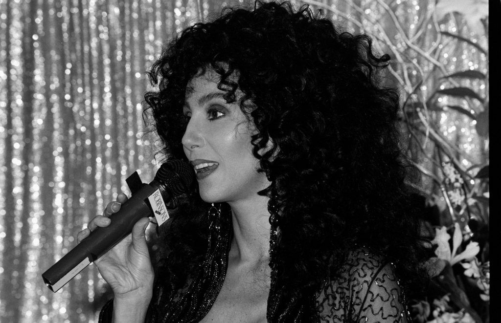 Cher with a microphone