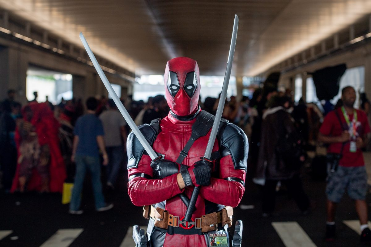 A fan cosplays as Deadpool from the Marvel Universe during the 2018 New York Comic-Con at on October 7, 2018.