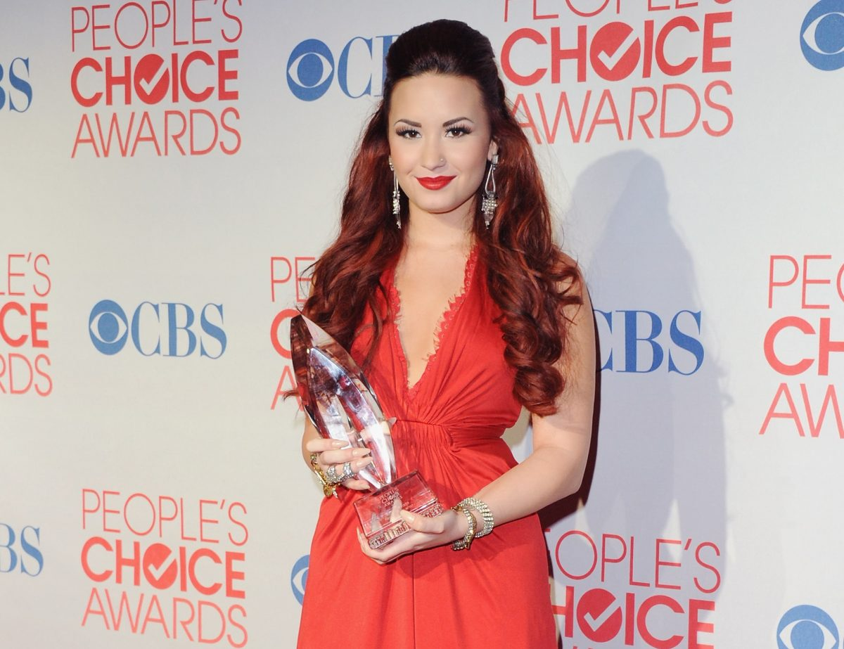 Demi Lovato poses at the 2012 People's Choice Awards Press Room on January 11, 2012 in Los Angeles, California.