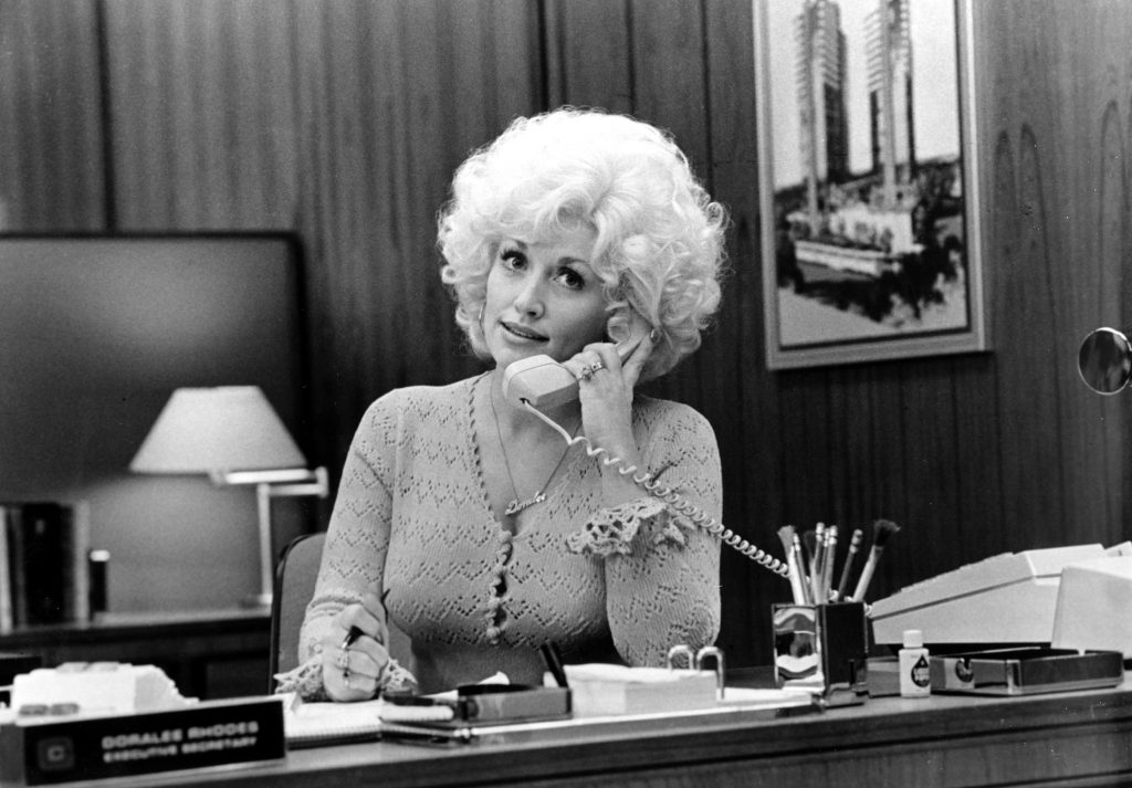 Dolly Parton answering a phone