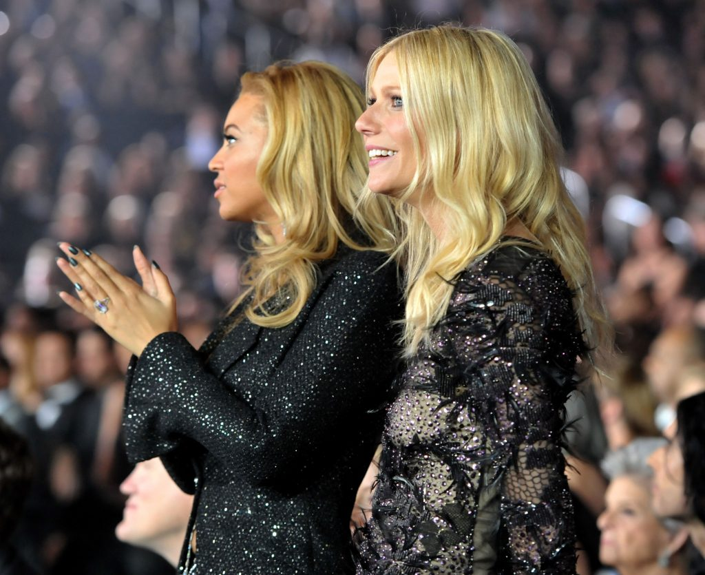 Beyoncé and Gwyneth Paltrow in front of a crowd