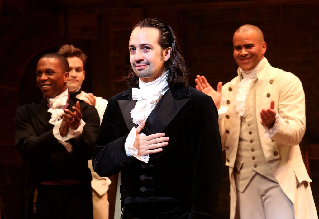 Lin-Manuel Miranda in front of other Hamilton cast members