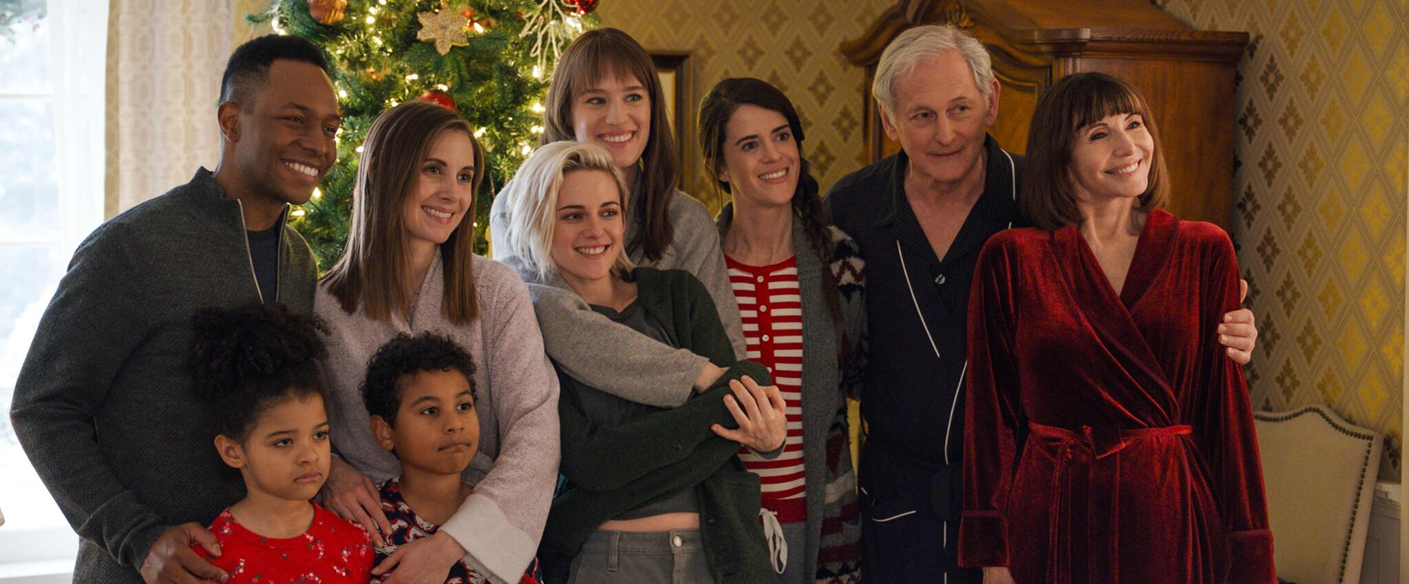 A family photo of the Caldwell family and spouses in 'Happiest Season'