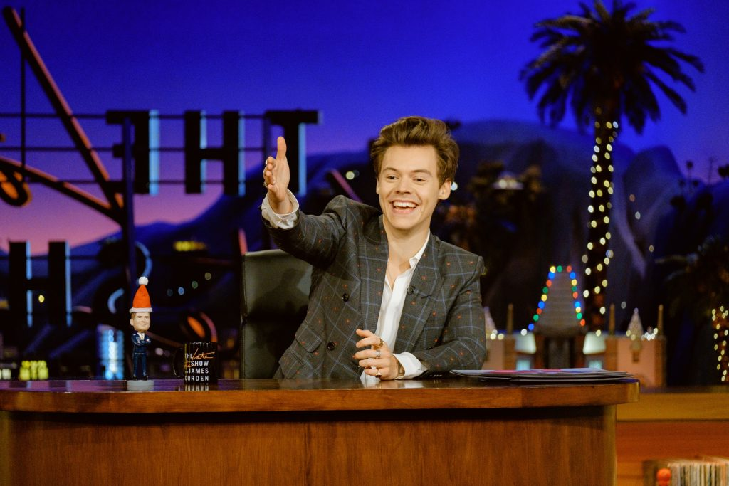 Harry Styles at a desk