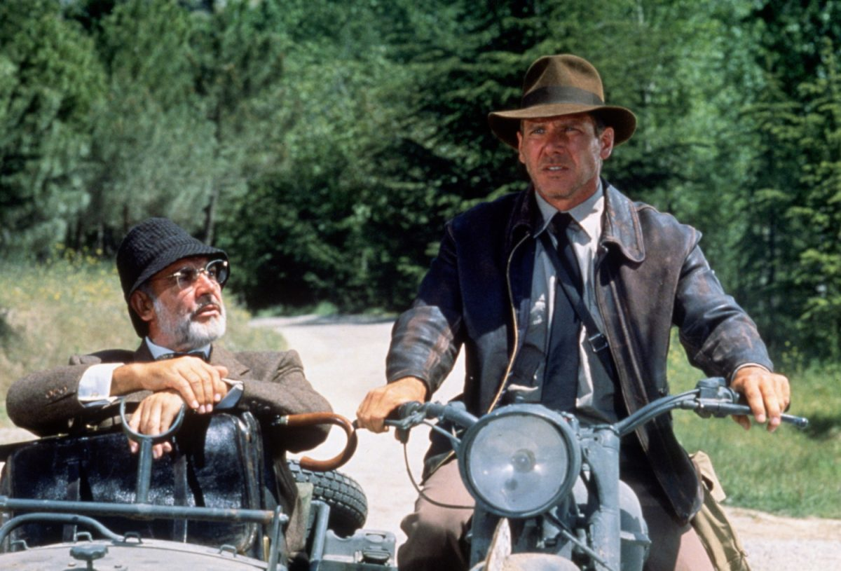 Sean Connery in sidecar and Harrison Ford on a motorcycle