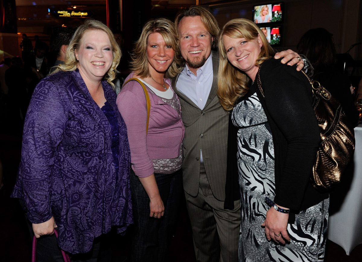 Janelle Brown with her husband and sister wives