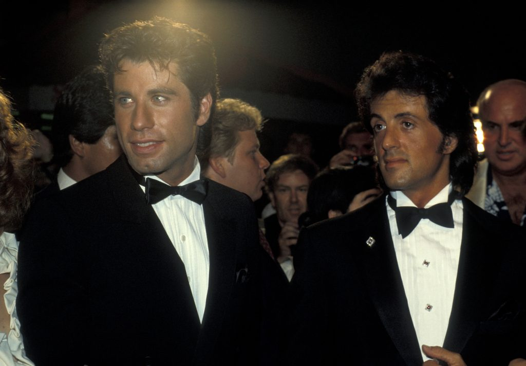 John Travolta and Sylvester Stallone in suits