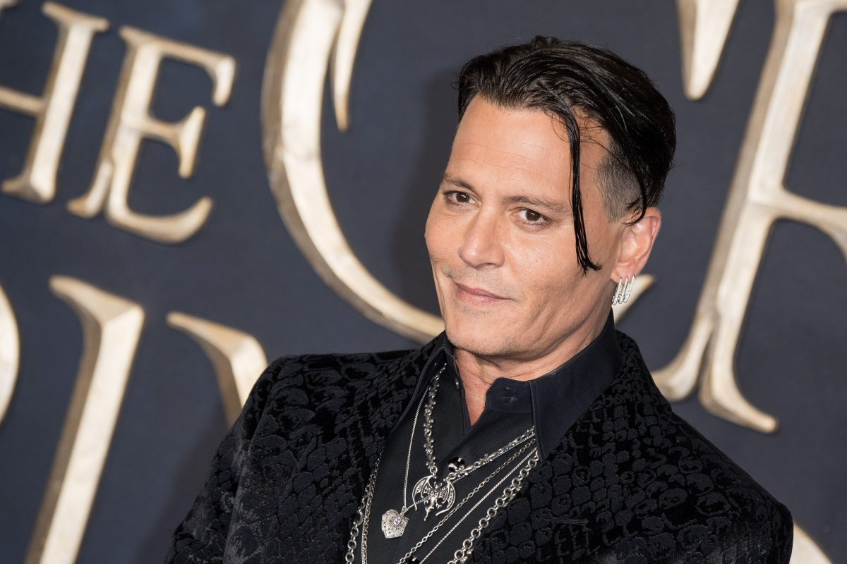 Johnny Depp attends the UK Premiere of 'Fantastic Beasts: The Crimes Of Grindelwald' on November 13, 2018 in London, England.