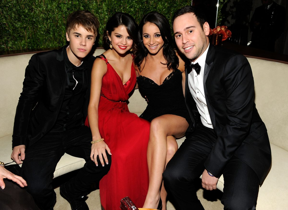 Justin Bieber, Selena Gomez, guest, and Scooter Braun attend the 2011 Vanity Fair Oscar Party on February 27, 2011, in West Hollywood, California.