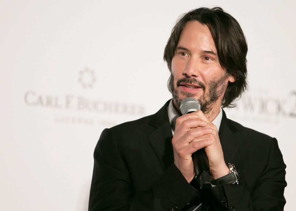 Keanu Reeves with a microphone