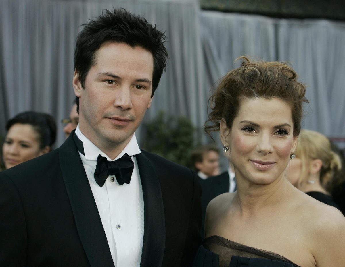 Keanu Reeves and Sandra Bullock arrive for the 78th Academy Awards