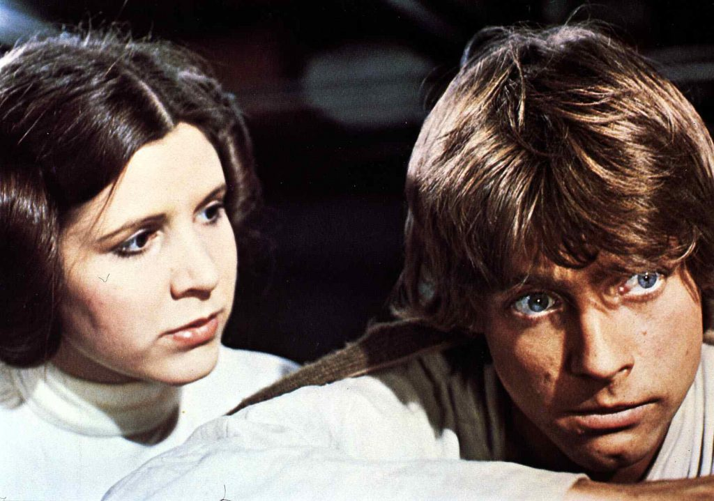 Princess Leia and Luke Skywalker in front of a dark background
