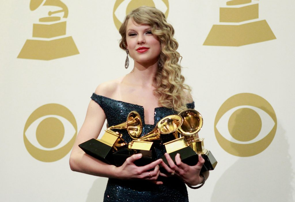 Taylor Swift poses with her Grammys at the 2010 Grammy Awards
