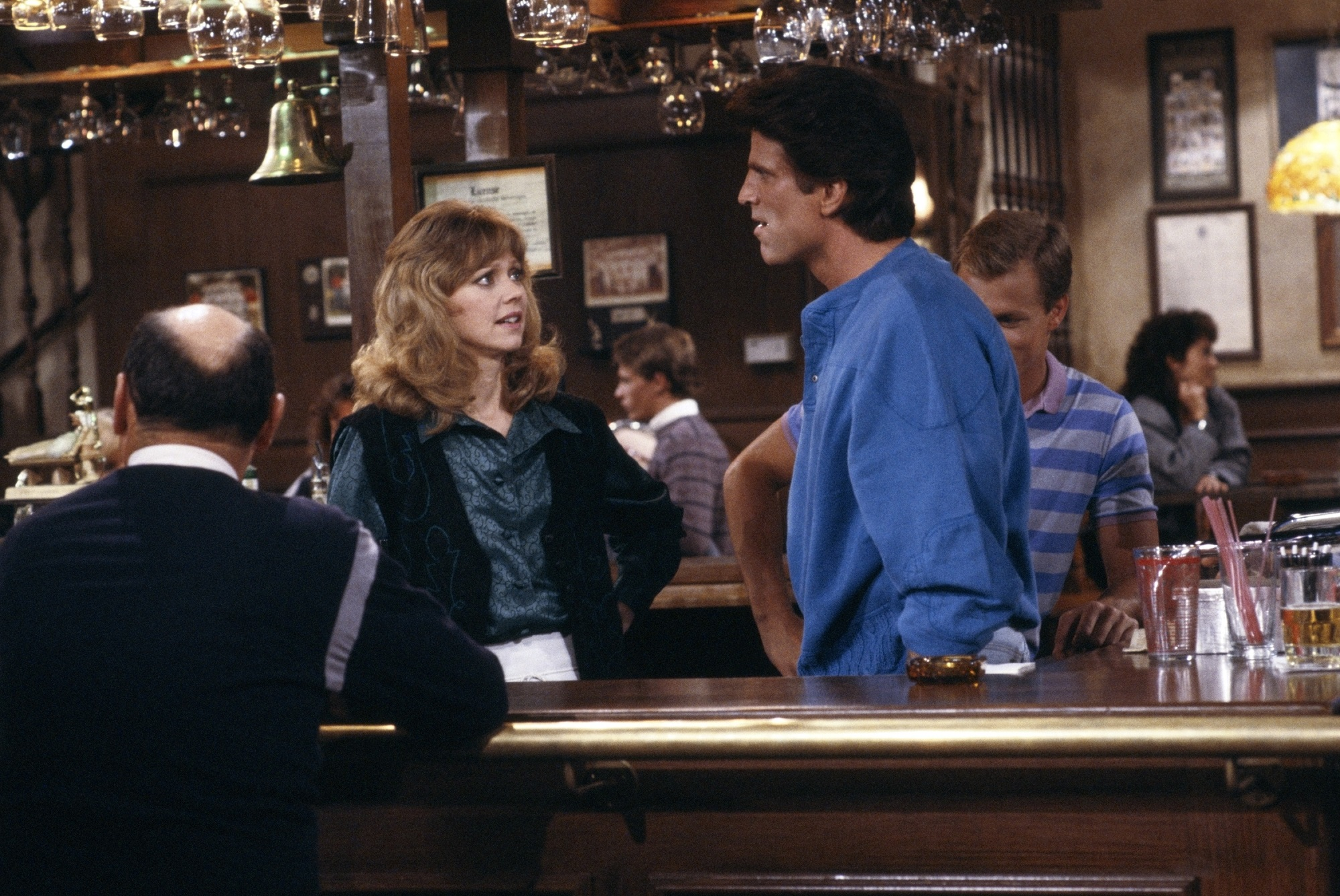 Shelley Long as Diane Chambers, Ted Danson as Sam Malone on Cheers