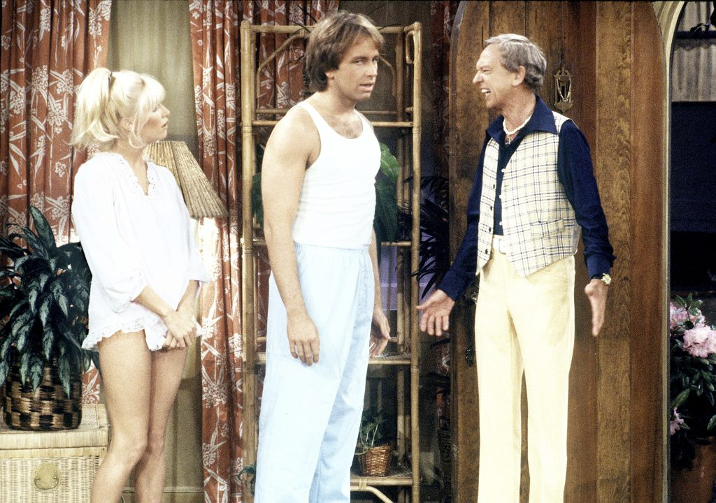 Suzanne Somers, John Ritter and Don Knotts from Three's Company near curtains