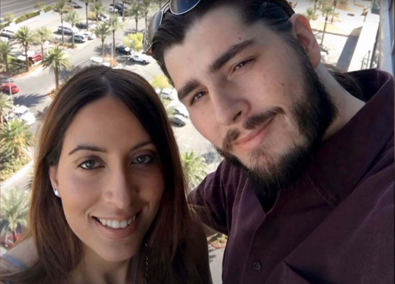 Andrew Kenton poses with Amira from 90 Day Fiancé