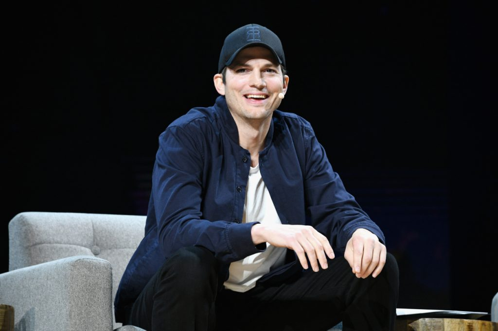 Ashton Kutcher speaking during a conference