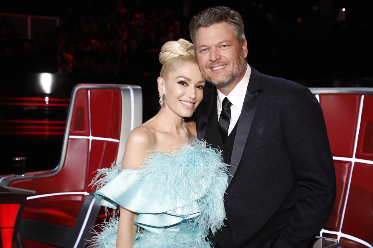Blake Shelton and Gwen Stefani posing next to each other on 'The Voice' in 2019
