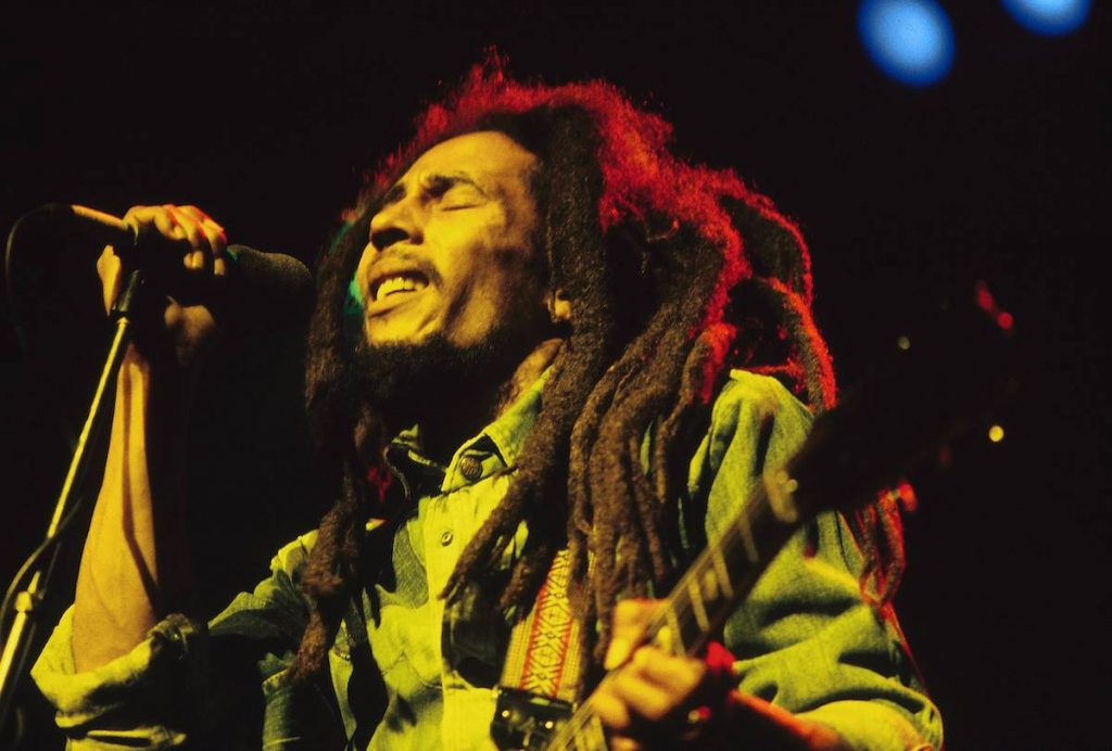 Bob Marley performing live on stage at the Brighton Leisure Centre | Mike Prior/Redferns