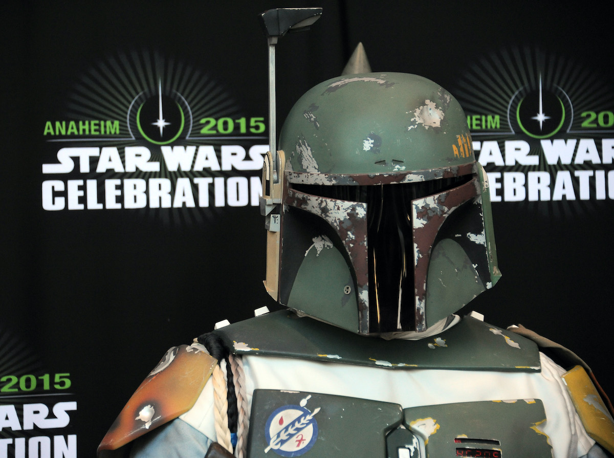A cosplayer dressed as Boba Fett at Star Wars Celebration