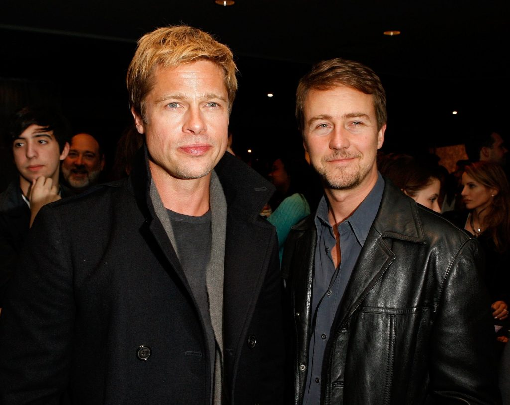 (L-R) Brad Pitt and Edward Norton smiling, looking to the right of the camera