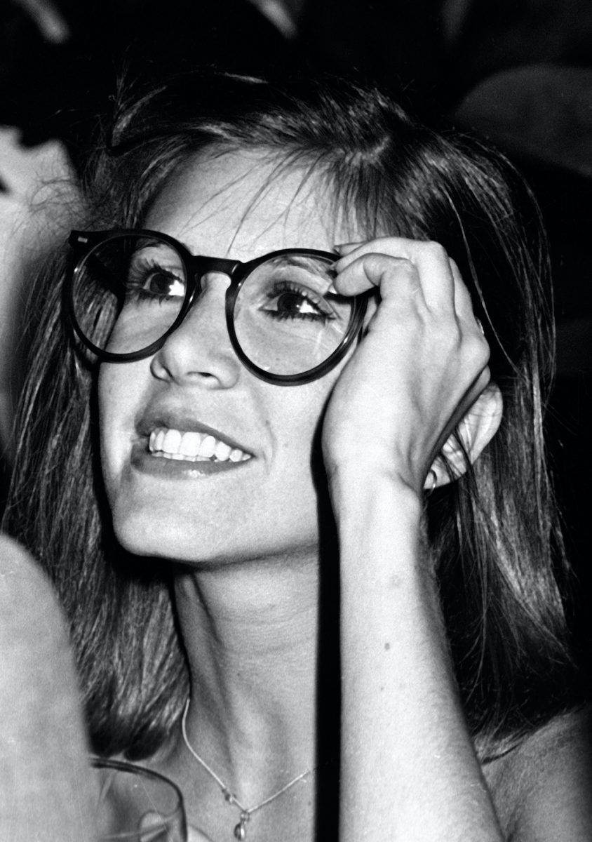 Carrie Fisher attends Giorgio Armani Fashion Show on September 16, 1980