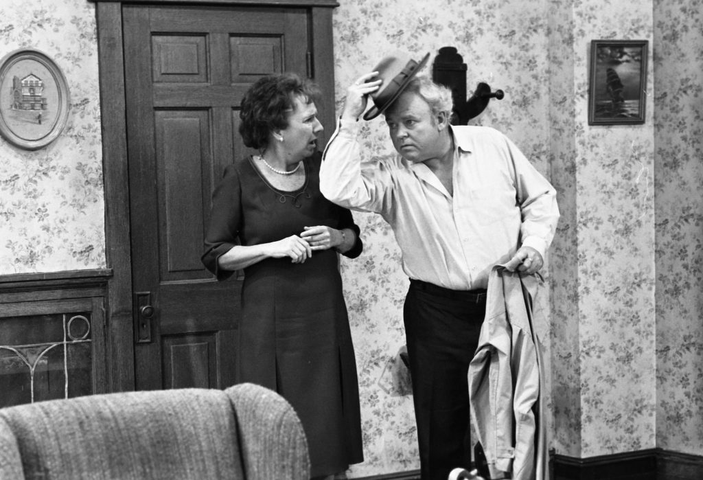 Carroll O'Connor and Jean Stapleton on the set of 'All in the Family' in 1978 | Ron Eisenberg/Michael Ochs Archives/Getty Images