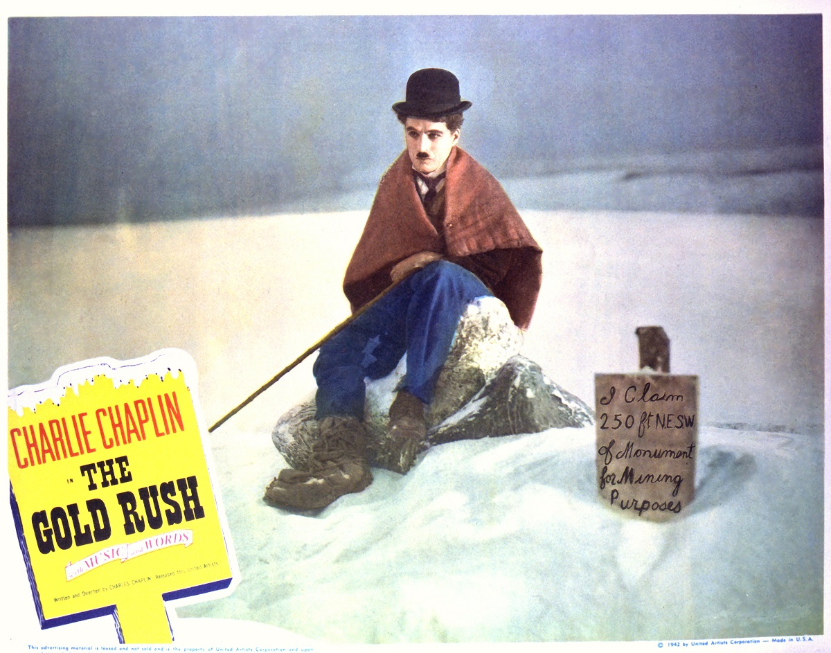A lobby card for 'The Gold Rush' featuring Charlie Chaplin