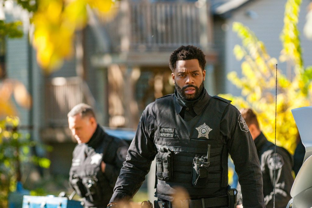 LaRoyce Hawkins as Kevin Atwater wearing a police uniform in front of a blurred background