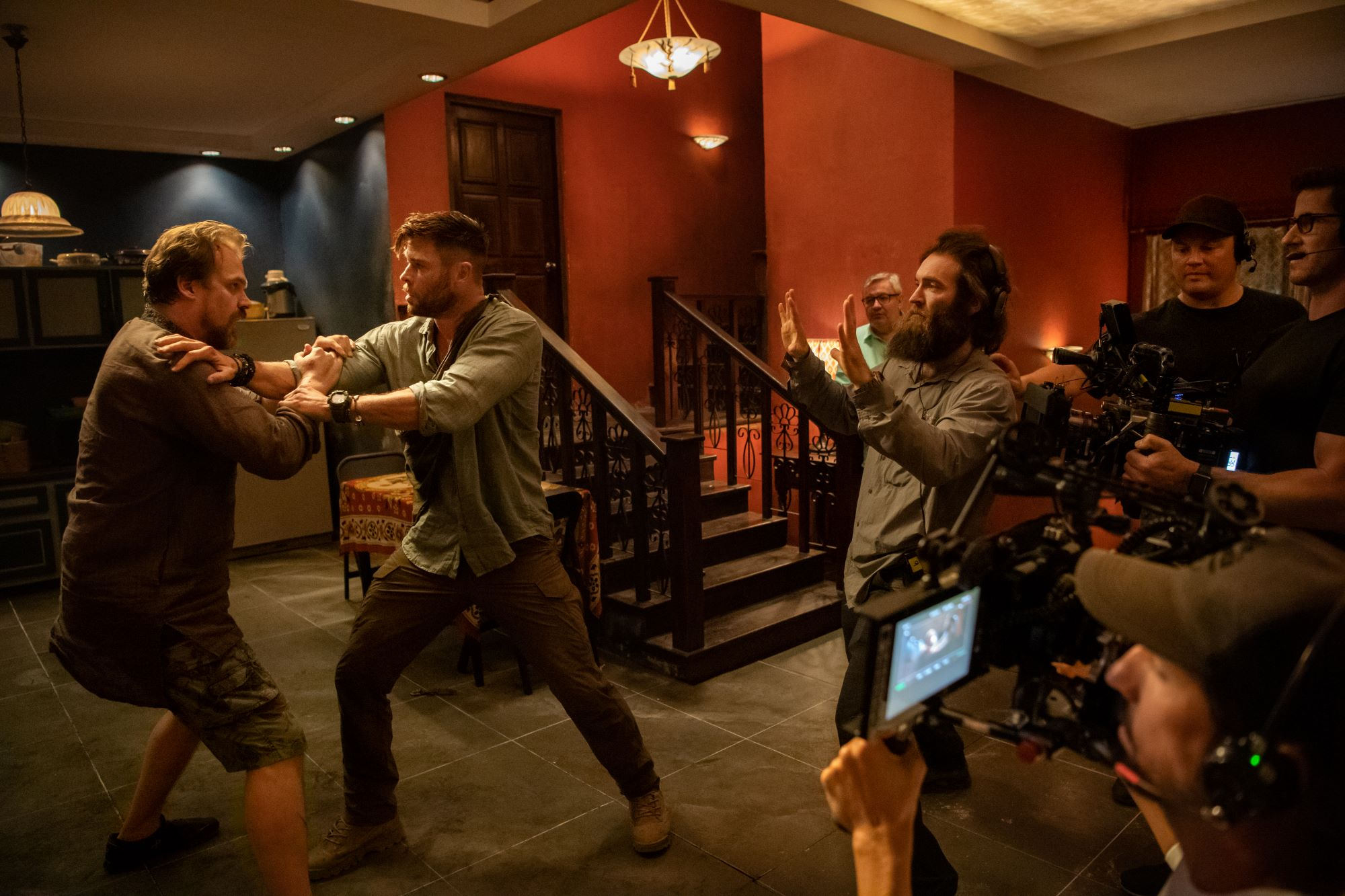 David Harbour, Chris Hemsworth, and Sam Hargraves filming 'Extraction'
