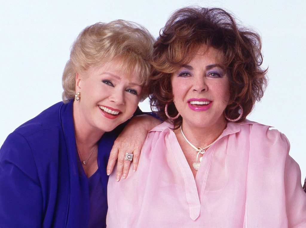 Debbie Reynolds and Elizabeth Taylor in a press photo for 'These Old Broads' written by Carrie Fisher | Timothy White/Walt Disney Television via Getty Images