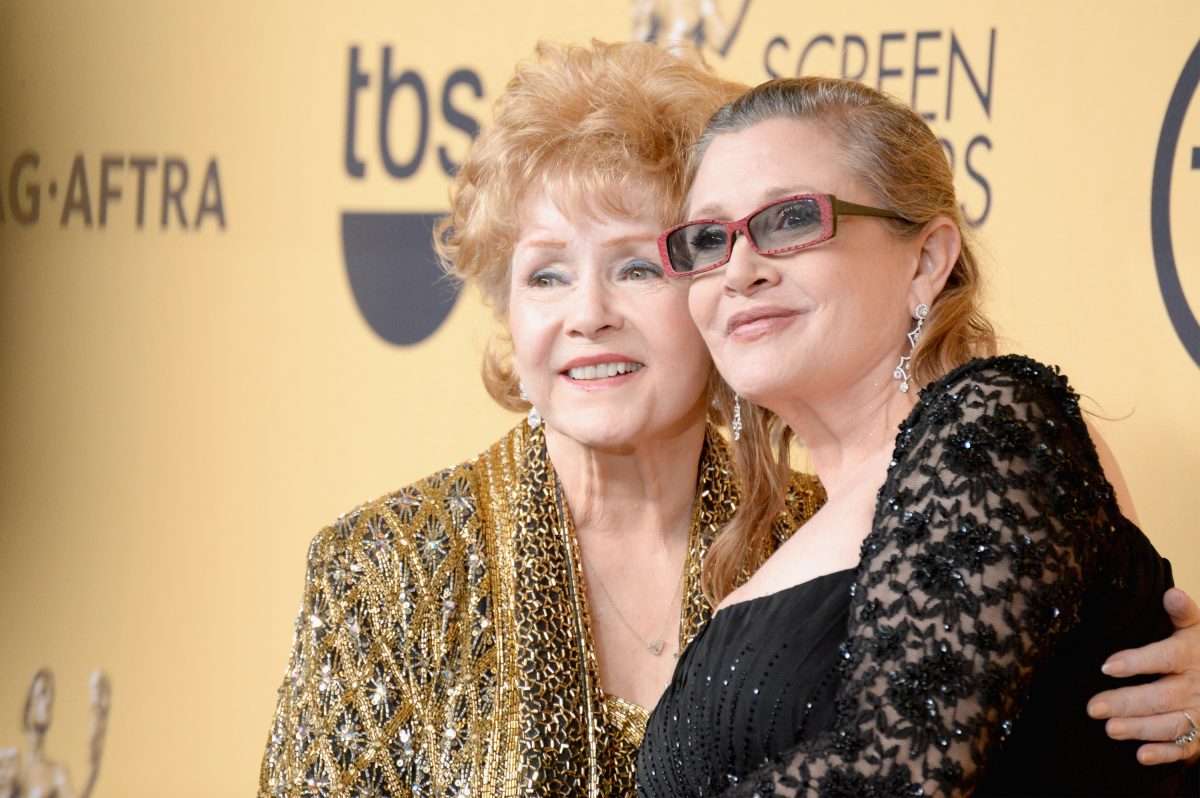 Actresses Debbie Reynolds (L) and Carrie Fisher pose in the press room at the 21st Annual Screen Actors Guild Awards at The Shrine Auditorium on January 25, 2015 in Los Angeles, California.