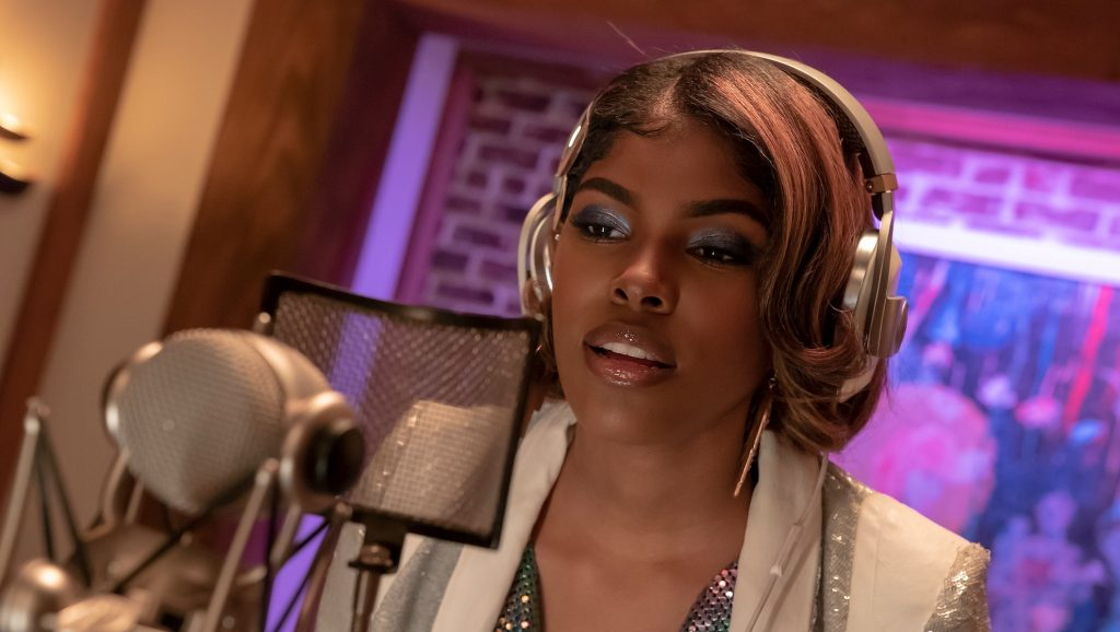 Diamond White speaking into a microphone on 'Empire'
