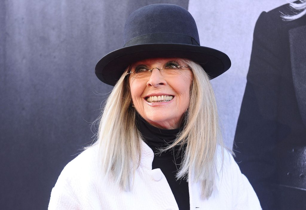 Diane Keaton smiling, looking to the left