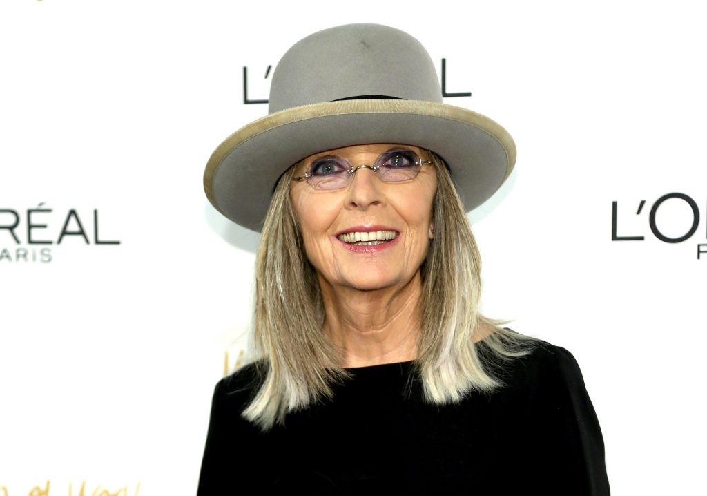 Diane Keaton smiling in front of a white background